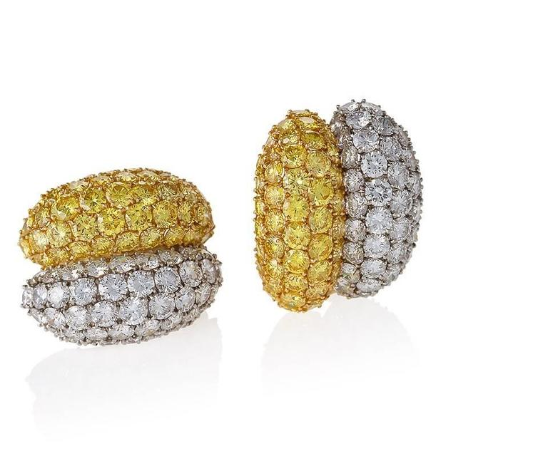 A pair of Estate 18 karat gold and platinum earrings with white and yellow diamonds by Van Cleef & Arpels. The earrings have 96 round-cut white diamonds with an approximate total weight of 10.50 carats, F-G color, VS clarity and 96 round-cut
