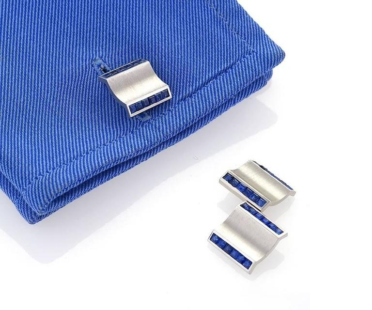 A Retro platinum and blue sapphire dress set that consists of a pair of double sided cuff links with 3 matching dress studs. There are 72 square cut blue sapphires with an approximate total weight of 3.75 carats. With box. Circa 1940's.   Signed,