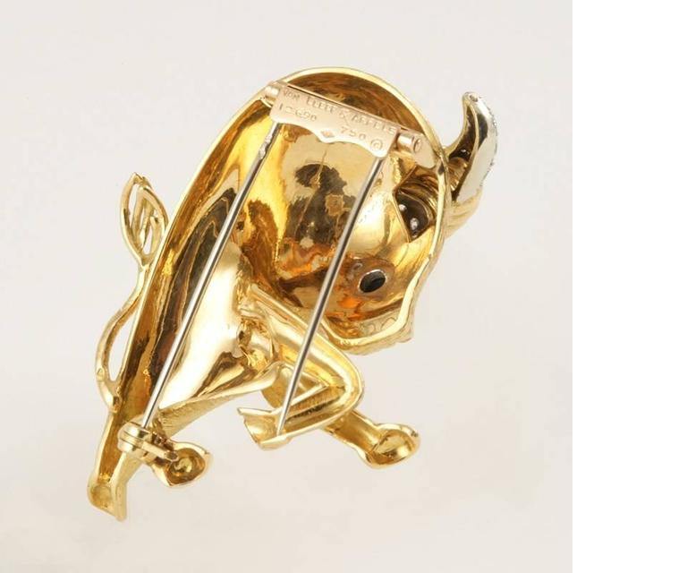 """A French Mid-20th Century 18 karat gold """"Taureau"""" brooch with diamonds and onyx by Van Cleef & Arpels. The brooch has 22 round-cut diamonds with an approximate total weight of .50 carats, an onyx cabochon eye. The whimsical bull was from the VCA 'La"""