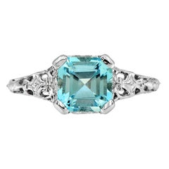 10 Karat White Gold Blue Topaz Filigree Ring
