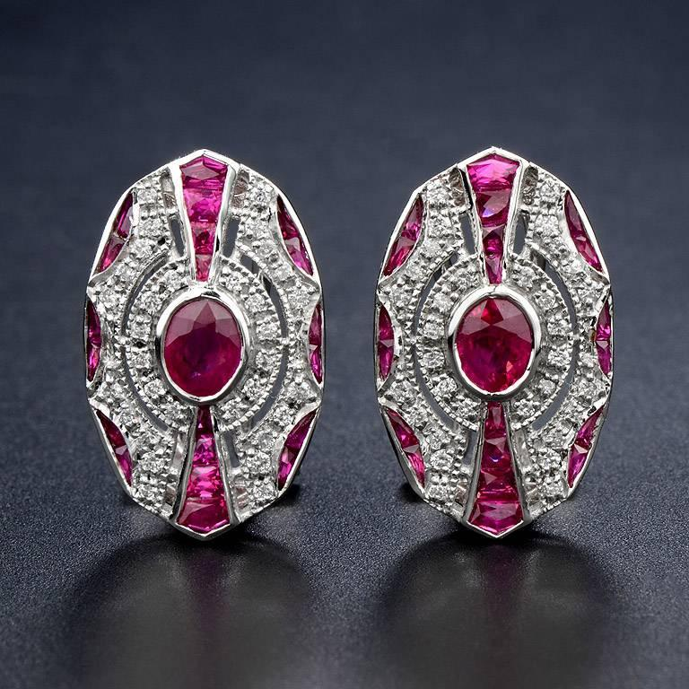 Oval Shape Burmese Ruby 2 pieces 0.82 Carat in the center. Surrounded by 64 pieces 0.40 Carat Diamond and French Cut Ruby 40 pieces 3.00 Carat. Set on 18K White Gold Clip-on Earrings.