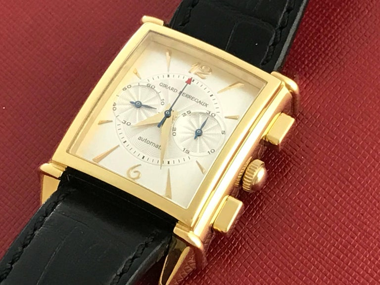 Girard Perregaux Vintage 1945 Model 2599 certified pre-owned automatic men's wrist watch. Chronograph with beautiful silvered guilloche dial, gold markers and Arabic numerals. Encased in stunning 18k yellow gold and measures 29mm x 46mm. Girard
