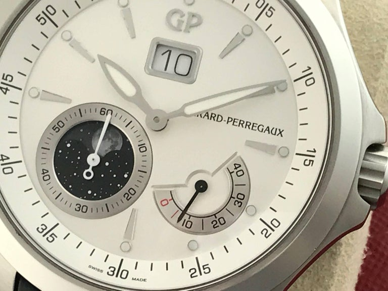 Girard Perregaux Traveller Model 49650-11-131-BB6A Pre-Owned Mens Automatic Winding-Big Date-Power Reserve and Moonphase wrist watch. Featuring a 44mm silver dial and luminous hands with a stainless steel case and exhibition back to view the
