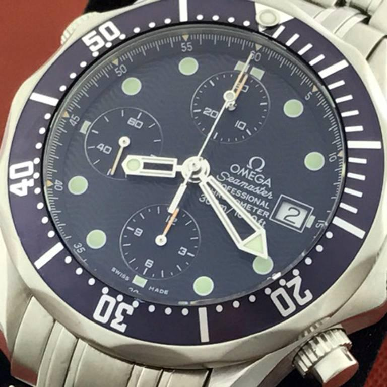 As New Omega Mens Seamaster Professional Chronograph, Model Number: Model 2599.80.00. Automatic Winding Movement, Chronograph with Helium Release Valve. Stainless Steel round style case with blue rotating bezel (42mm dia.). Stainless Steel Omega