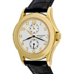 Patek Philippe Yellow Gold Travel Time Manual Wind Wristwatch