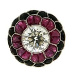 3.80 Karat Central Diamond, Platinum, Rubies and Onix Cocktail Ring
