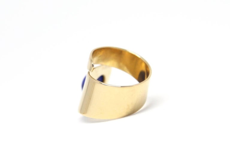 Unusual 18k yellow gold & lapis lazuli modernist ring designed by Jean Dinh Van for Cartier dating to the 1960's. Ring is both delicate yet bold in appearance. Currently the ring best fits a US size 5.5 or 6 however can be  adjusted slightly by a