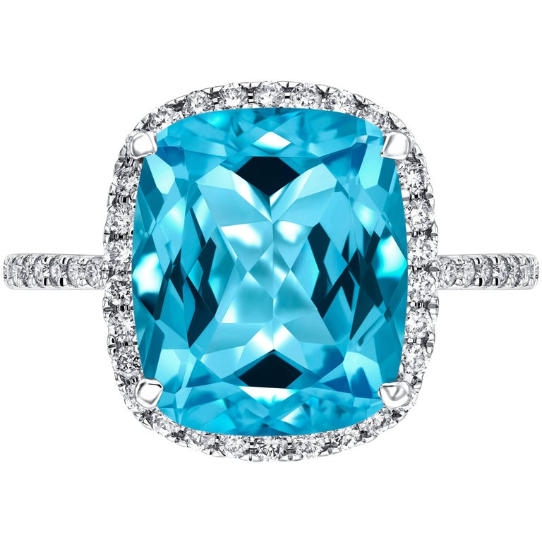 6 50 Ct Cushion Cut Blue Topaz 0 38 Carat Diamond Halo Ring In 18ct White Gold