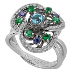 Monseo Blue Topaz, Tsavorites, Sapphires and Diamonds Flower Gold Ring