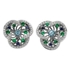 Monseo Blue Topaz, Tsavorites, Sapphires and Diamonds Flower Gold Earrings