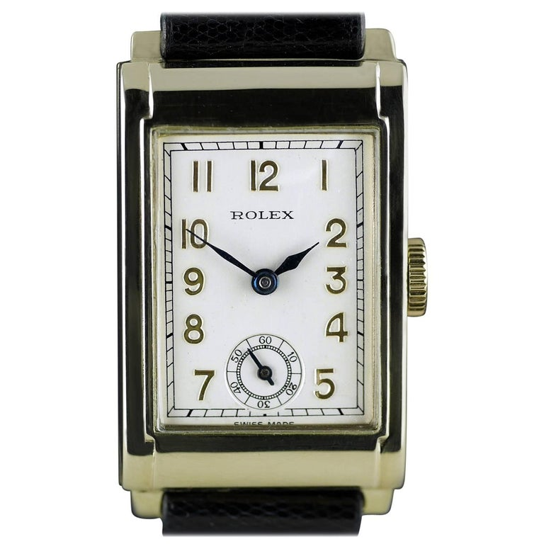 An Art Deco vintage wristwatch by Rolex dated 1934. Suitable for a woman, or a man that likes small watches.  15-Rubies (Jewels), Rolex, rectangular Ultra Prima HW movement.   Yellow gold 9ct case with stepped sides and overlaid middle panels