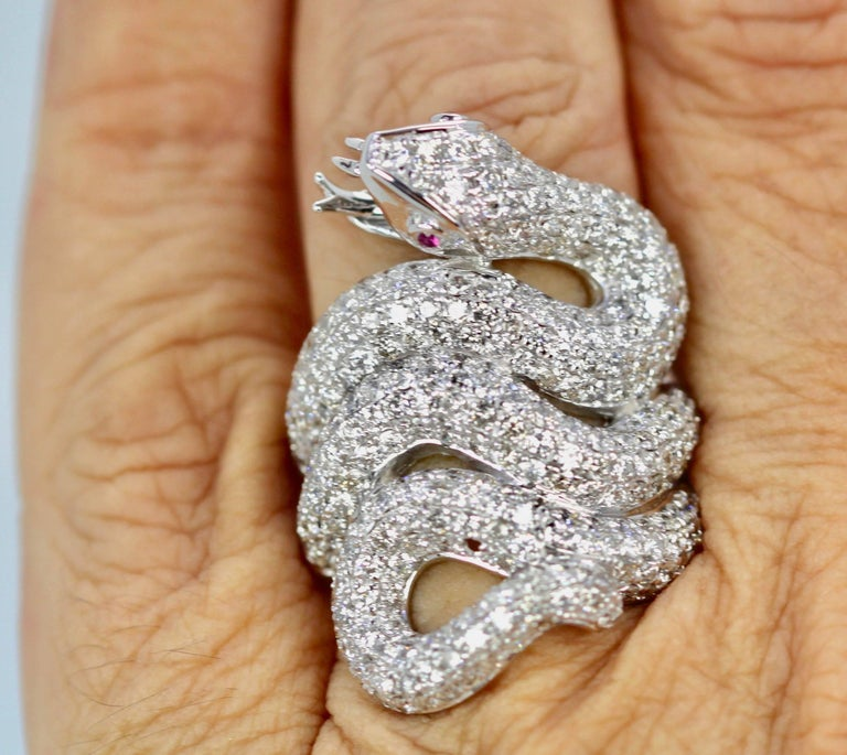 This Snake Ring is covered in Diamonds and is one of my favorites.  As you can see from the photo's this ring is large and covers my finger and it is dramatic.  For Snake lovers this is the dream snake ring, and all in Diamonds. This piece is new