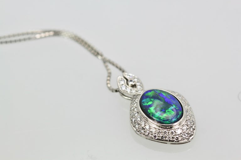 This Black Opal Platinum Diamond Necklace boasts 4.13 Carats as the matching ring does. The matrix on this Opal is really beautiful with gorgeous shades of green and blues.  This pendant is surrounded by round brilliant cut Diamonds VS1-SI1, G-H