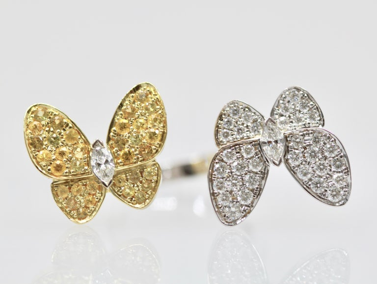 This Van Cleef White Diamond Yellow Sapphire Double Butterfly Ring has seldom been worn and is in wonderful condition.  This is from the flora and fauna collection and it is just beautiful.  The grace of these butterfly dancing in the wind is