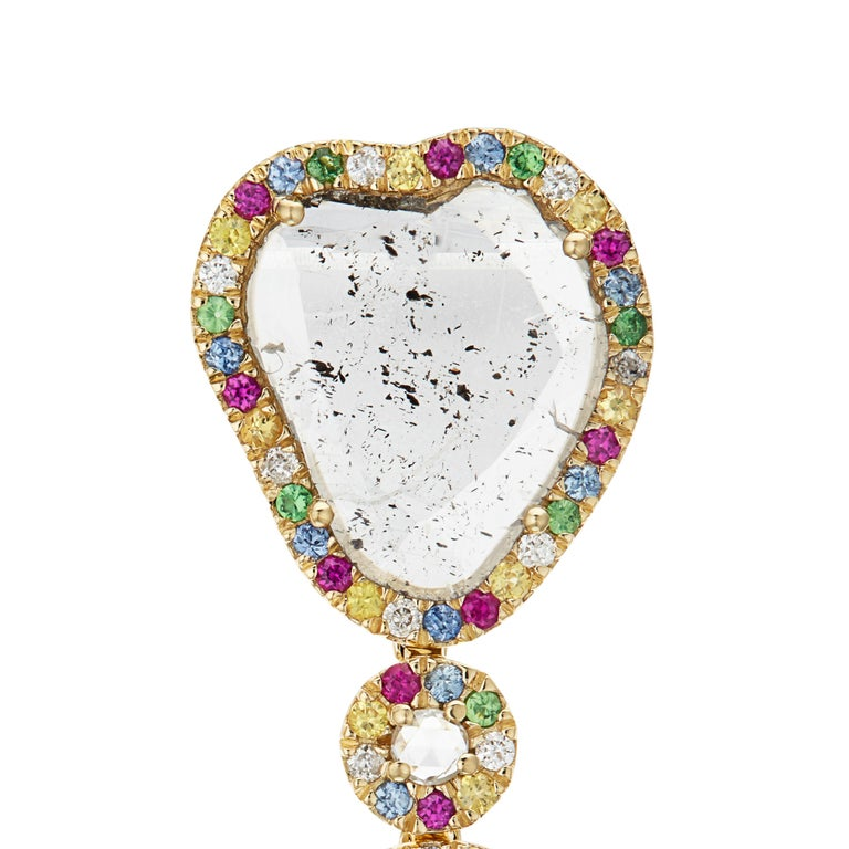 Celebrate in style with this colourful combination of sparkling diamonds, gleaming green tsavorites, sea blue sapphires, cherry red rubies and glowing yellow sapphires, encased in 18k gold and surrounding four stunning slice diamonds. The pendant