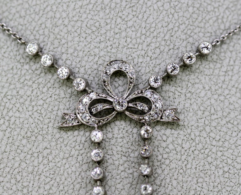 Art Deco platinum ladies necklace with jade and diamonds Made in France Circa 1920's  Approx Dimensions -  Necklace Length : 48.5 cm Pendant / Charm Size : 6.7 x 2.7 cm Weight : 12 grams  Diamonds -  Cut : Round Total Number of Diamonds : 40 Total