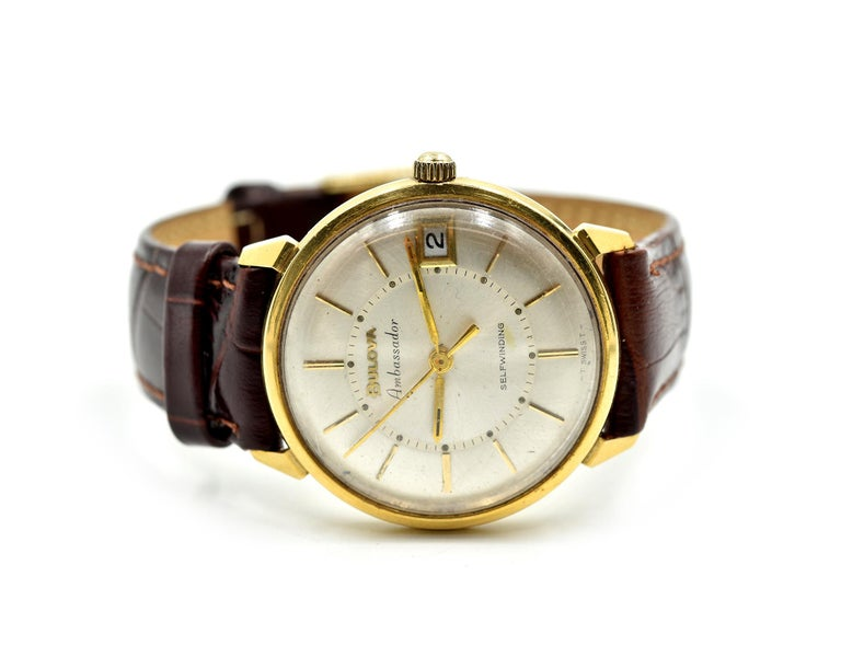 Movement: automatic, shock proof, anti-magnetic Function: hours, minutes, sweep seconds, date Case: 33mm 18k yellow gold case, acrylic (plastic) crystal Band: generic brown leather strap, gold plated buckle Dial: silver dial, gold hands, gold hour