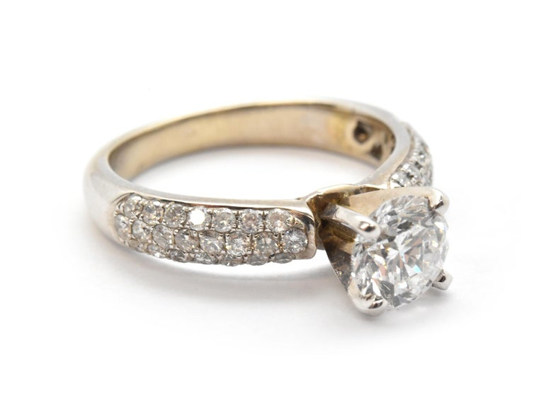 Designer: custom Material: 14k white gold Center Diamond: 1 round brilliant cut = 1.05ct Color: F Clarity: SI2 Mounting Diamonds: 44 round brilliant cuts = 0.53cttw Color: G Clarity: VS2 Ring Size: 4 (please allow two additional shipping days for
