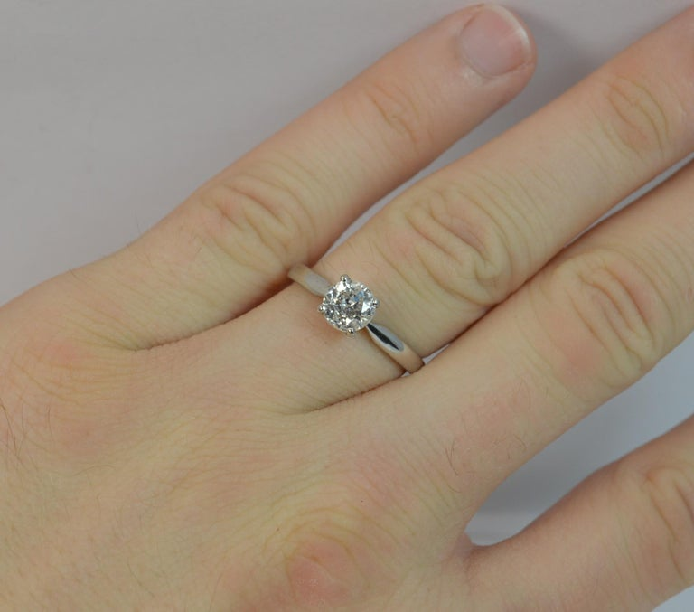 A beautiful Victorian period diamond solitaire ring.  A natural old cut diamond measuring 5.9mm in diameter. Mounted into a four claw setting. 1.06 carats as weighed prior to mounting. Very white, sparkly diamond. i1 clarity.  Modelled in a solid