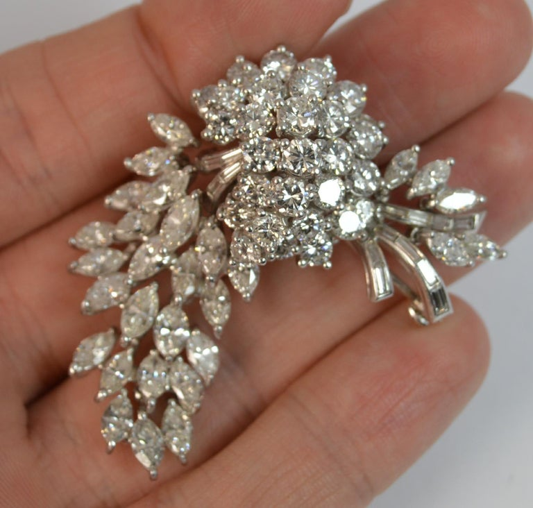 A stunning true vintage Platinum and Diamond brooch of floral spray design.  Set with over 10 carats of natural diamonds to include round brilliant, marquise and baguette cut diamonds.  VS clarity, f-g colour. Very clean and sparkly diamonds, well