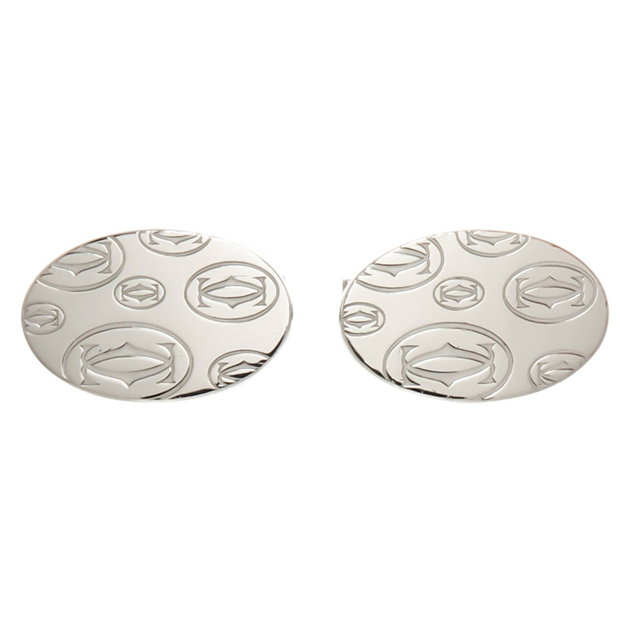 Circa:  2005 Sterling Silver Cartier Cufflinks with the Double C Cartier Logo Design on the top.
