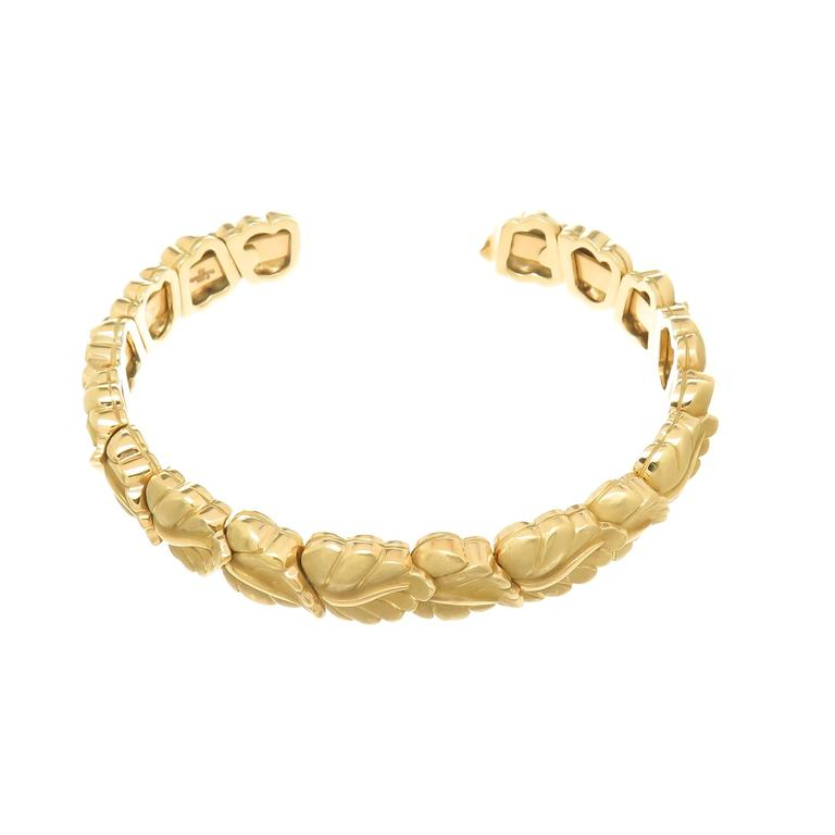 Circa 2002 Tiffany & Company 18K Yellow Gold Leaf Bracelet, measuring 3/8 inch wide and having an opening of 1 inch, this bracelet is flexible with each section attached separately to give it movement and so it can fit most any wrist. The leaves are