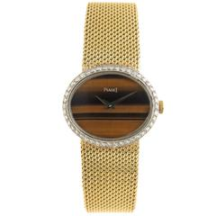 Piaget Ladies Yellow Gold Diamond Tiger Eye Dial Wristwatch