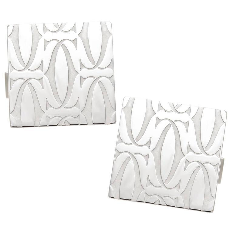 Cartier CC Logo Silver Cufflinks For Sale