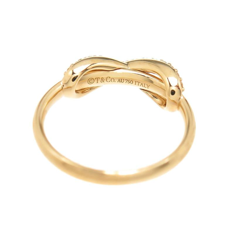 3ec30ce28f066 Circa 2015 Tiffany & Company 18K Yellow Gold Infinity Collection ring.  Set with Round