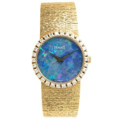 Piaget Yellow Gold Diamond Opal Manual Wind Wristwatch, circa 1970s