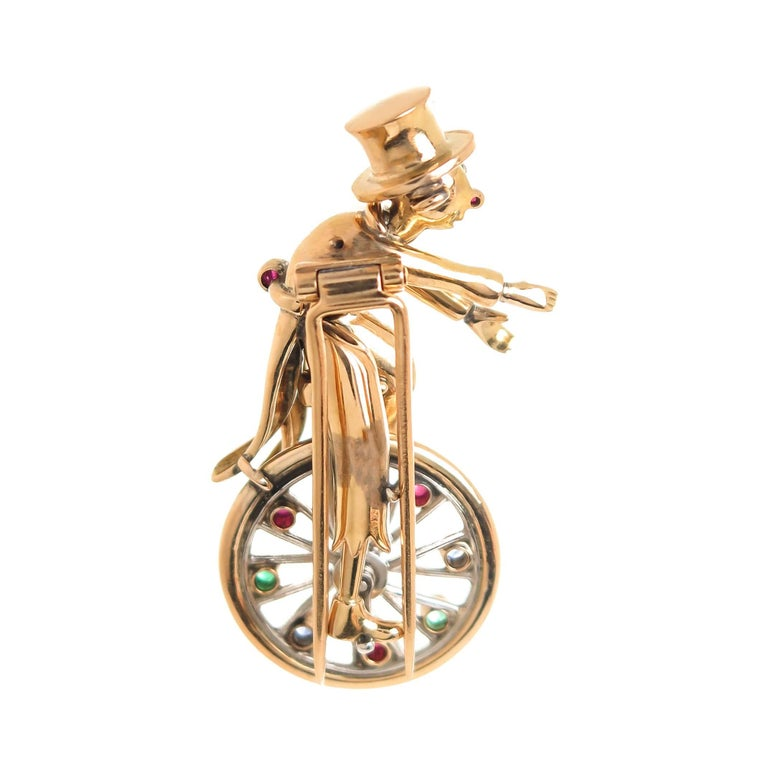 Whimsical Yellow Gold and Gem Set Figural Unicycle Clown Clip Brooch, 1940s In Excellent Condition For Sale In Chicago, IL