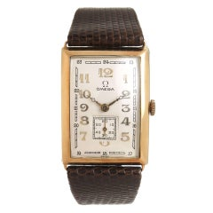 Omega Yellow Gold Oversize Curved Manual Wristwatch, circa 1930