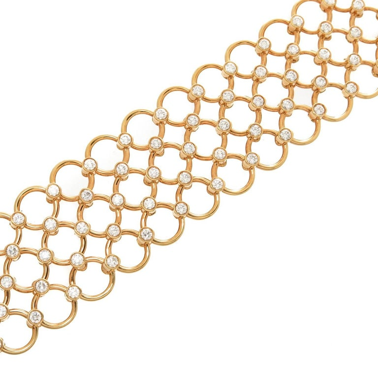 Circa 2005 Tiffany & Company 18K yellow Gold Flexible Circles link Bracelet, set with 115 Round Brilliant cut Diamonds totaling 4.60 Carats, measuring 7/8 inch wide and 7 1/4 inch in length. Excellent, almost unworn condition and comes in the