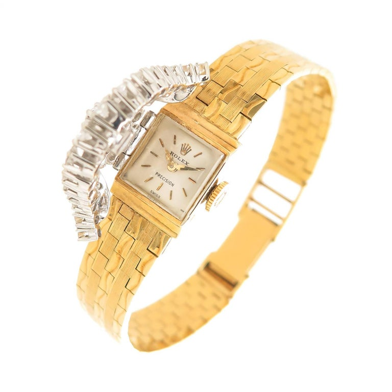 Circa 1960s Rolex ladies Covered Bracelet Watch, 18K Yellow Gold Signed Rolex Case with a White Gold Hinged Cover set with Fine color Round Brilliant cut Diamonds Totaling 1.25 Carats. 17 Jewel mechanical, manual Wind Movement, Original white dial