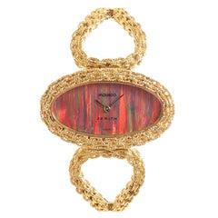 Movado Zenith Ladies Yellow Gold Fire Opal Dial Bracelet Wristwatch, 1970s