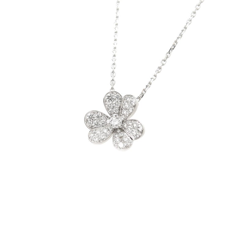Circa 2009 Van Cleef and Arpels Frivole Collection 18k White Gold Flower Pendant. Measuring 15 X 15 MM and suspended from a 16 inch chain. Set with round Brilliant cut Diamonds totaling .80 Carat, grading as F in color and VVS in Clarity.  Excellent