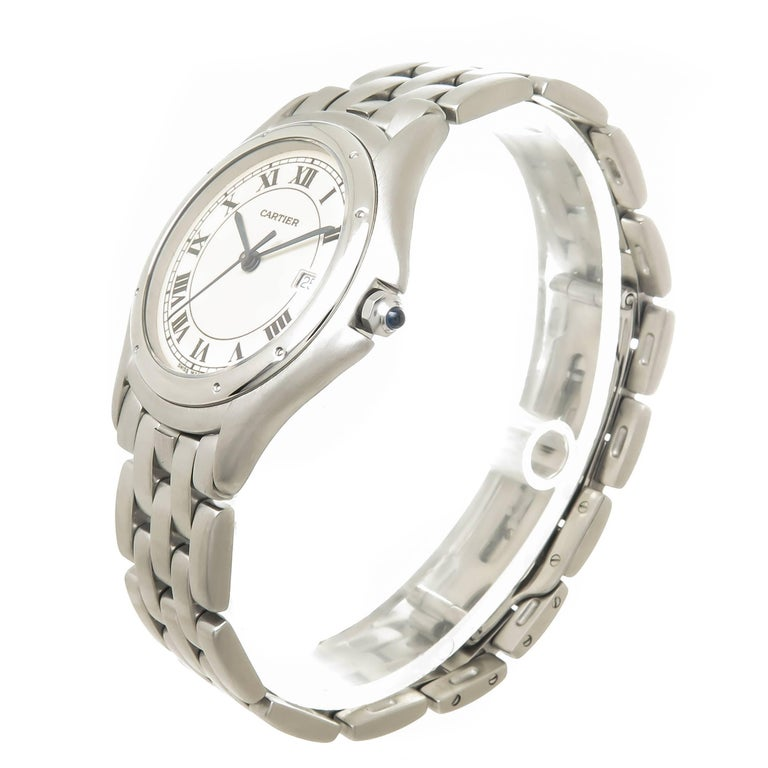 Circa 1990s Cartier Cougar collection Wrist watch 38 X 33 M.M. Stainless Steel case.  Quartz Movement, White Dial with Black Roman Numerals, Sweep seconds hand and a Calendar window at the 3 position. 5/8 inch wide Stainless Steel Panther link