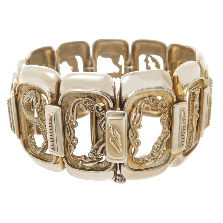 Circa 1980s Erte Sterling Silver Numbers Suite Bracelet in the Famous Erte Art Deco Style, measuring 7 1/2 inch in length and 1 3/8 inch wide. Signed, Numbered and also having the stamp of CFA Circle Fine Art Galleries. Comes in original