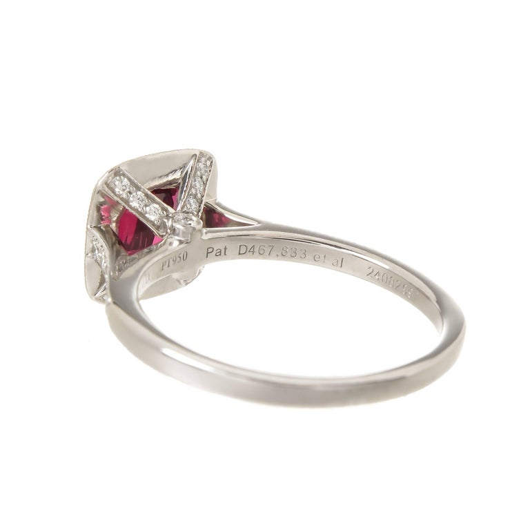 Circa 2015 Tiffany & Company Platinum Ring, centrally set with a very fine, intense color Cushion cut Rubellite of approximately 1.50 Carats and surrounded by 16 Round Brilliant cut Diamonds totaling .48 Carat, further set with 12 Round Brilliant