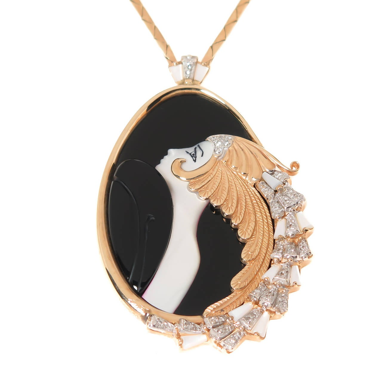 "Circa 1980s  Erte "" Beauty and the Beast"" Necklace, 14k Yellow Gold, Diamonds, Onyx and Mother of Pearl. The pendant portion measures 2 3/4 inch in length X 1 3/4 inch wide. Suspended from an 18 inch 14K Yellow Gold chain. Signed, numbered"