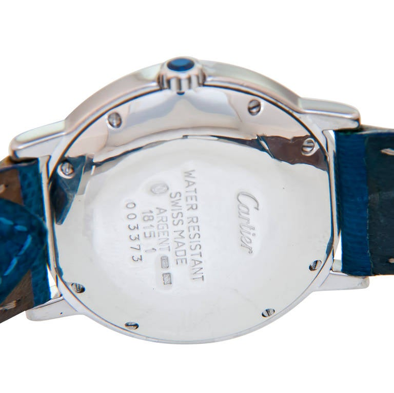 Cartier Sterling Silver Must De Cartier Mid Size Wristwatch. 32mm Polished Water Resistant Case, Quartz Movement, two tone White and Cream Dial with Sub Seconds, Sapphire Set Crown. Original Blue Lizard Strap with Steel Cartier Deployment Buckle.