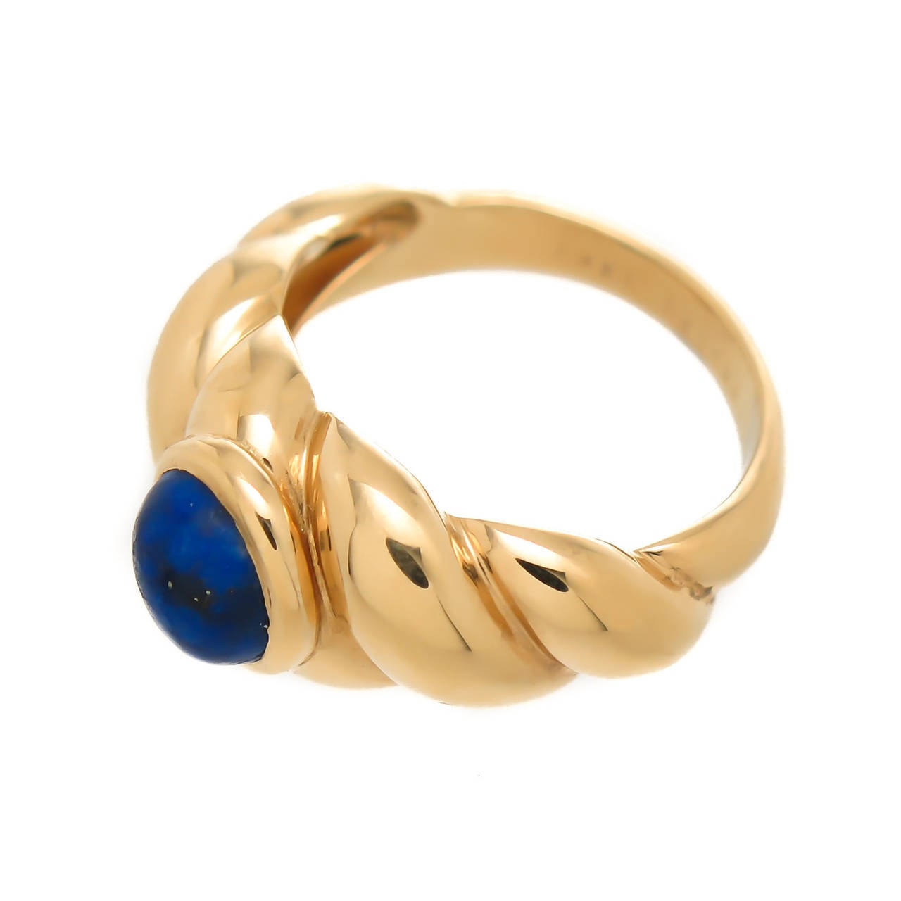 Circa 2000 Van Cleef & Arpels 18K Yellow Gold Ring, centrally set with an oval Lapis Lazuli. Signed and numbered, finger size = 6 1/4