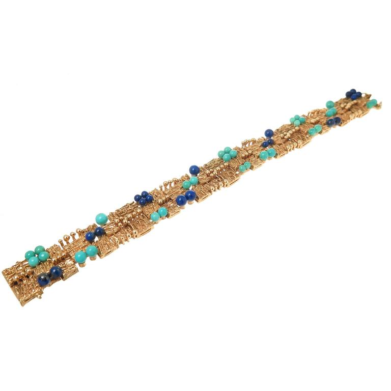 Circa 1960s 14K yellow Gold bracelet all hand made in a Modern design of individual textured links with Gold beads and further set with Turquoise and Lapis beads of varying sizes. Measuring 5/8 inch wide and 7 1/2 inch in length.