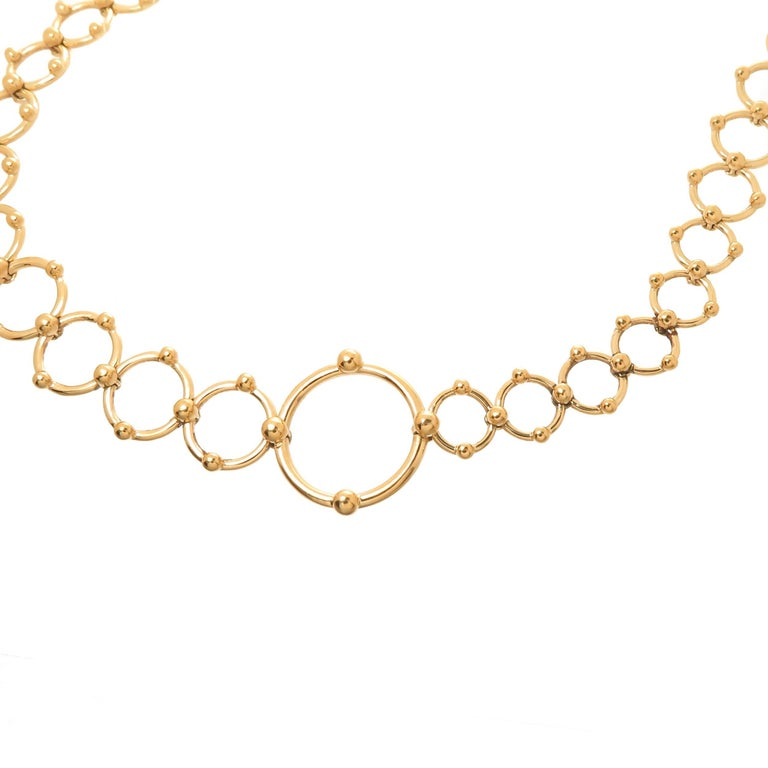 Circa 2005 Tiffany & Company 18k Yellow Gold Circles necklace, measuring 30 inches in length and weighing 61.3 Grams. Consisting of Sold Links in tapering sizes from 1/4 inch up to 5/8 inch. Signed on the Largest circle link. Comes in the original