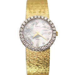Piaget Ladies Gold and Diamond and Mother-of-pearl Dial Quartz Wrist Watch