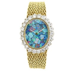 Rolex Yellow Gold Diamond and Opal Dial Ladies Manual Wind Wristwatch