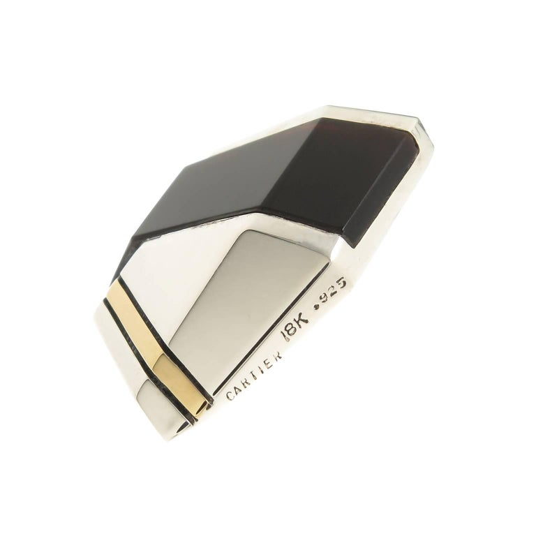 Circa 1980 Cartier 18K yellow Gold, Sterling silver and Onyx Earrings, measuring 1 1/4 inch in length and 7/8 inch wide. Having a post back, the earrings are in excellent condition and come in a Suede Cartier Pouch.