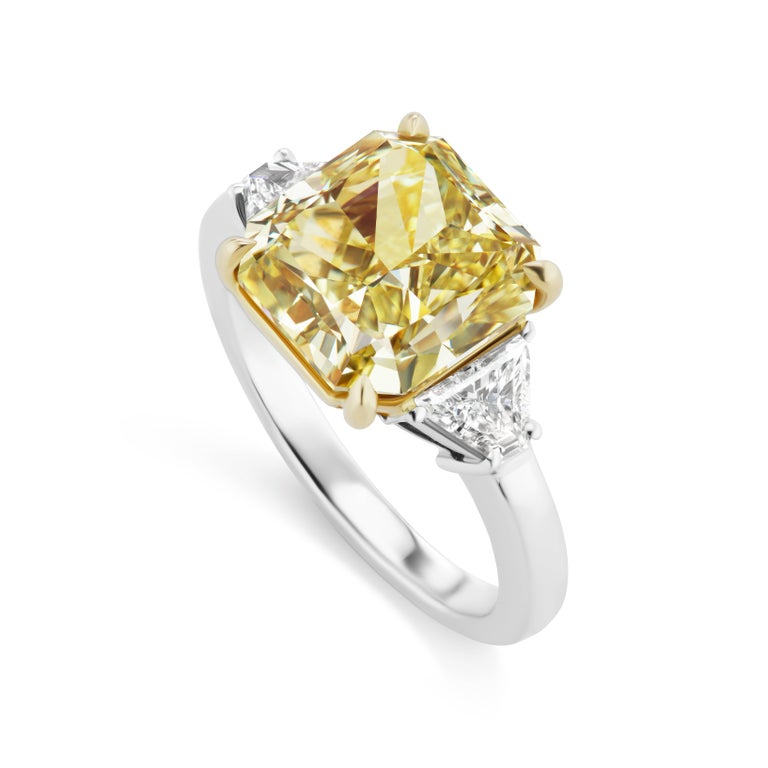 This Scarselli  Classic  6.44 carat Radiant Cut Fancy Intense Yellow Diamond is VS2 Clarity with Trapezoid Shape side diamonds mounted in Platinum and 18 karat yellow gold.  This ring is sizeable and a Scarselli Classic -- available in many diamond