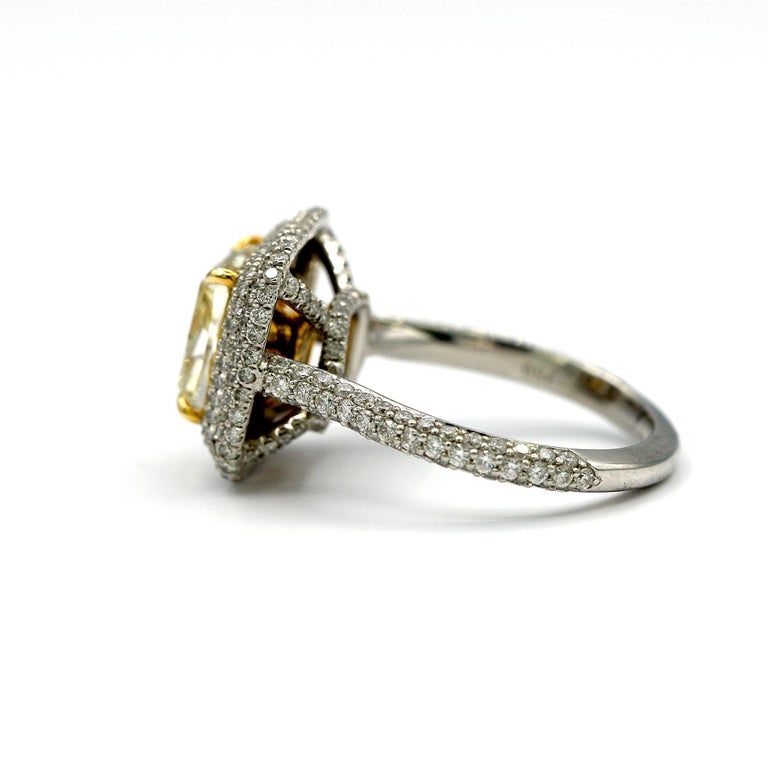 Contemporary 4.25 Carat EGL Fancy Light Yellow Cushion SI1 Diamond with Pave Platinum Ring For Sale