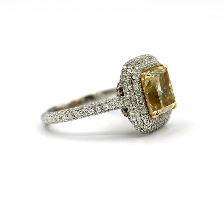 Cushion Cut 4.25 Carat EGL Fancy Light Yellow Cushion SI1 Diamond with Pave Platinum Ring For Sale